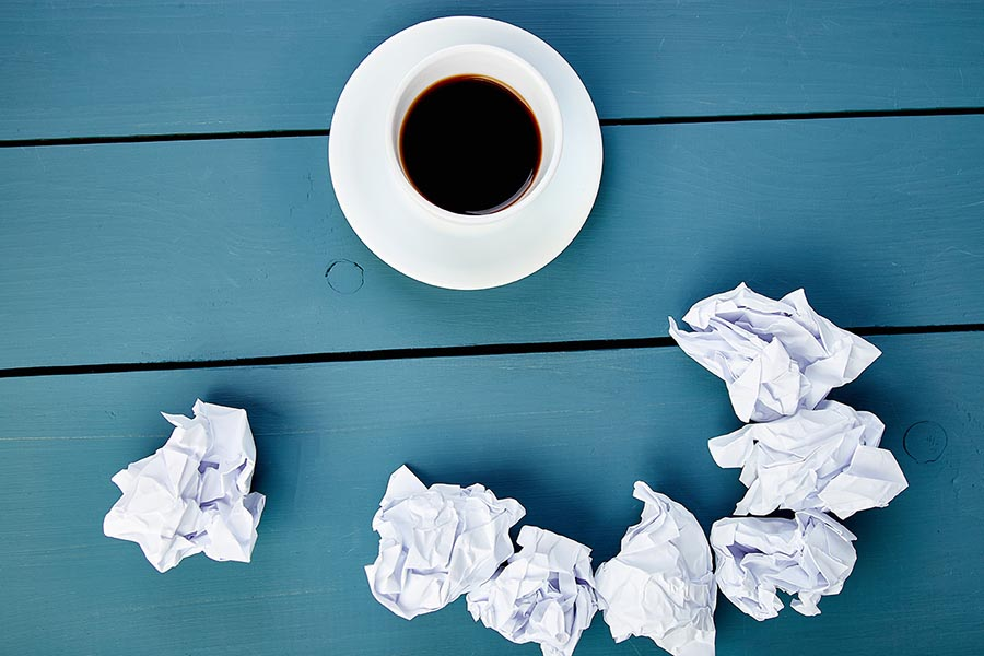 Coffee and balled paper